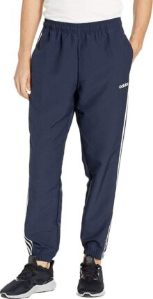 Adidas Essentials Pantalones Cortavientos de 3 Rayas para Hombre